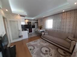 Двухкомнатная квартира в Коньяалты по выгодной цене!