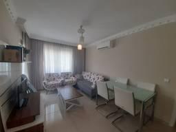 Выставлена на продажу просторная, меблированная 3-х комнатная квартира в Коньяалты